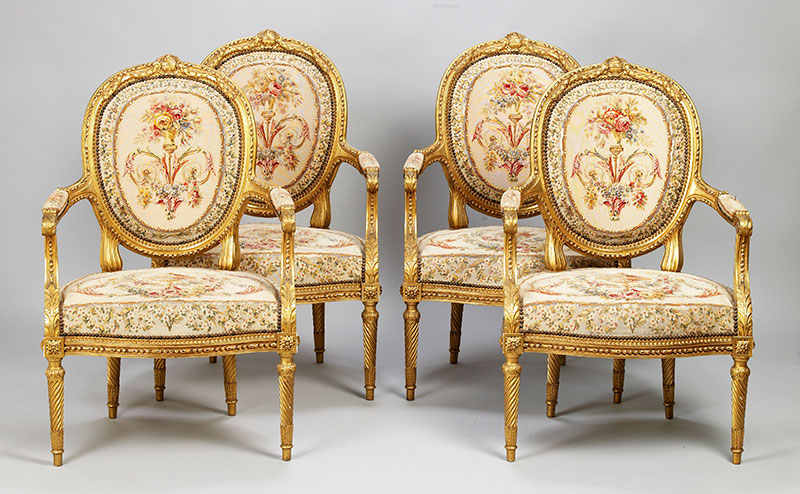 Four Louis XVI style carved gilt-wood and tapestry fauteuils