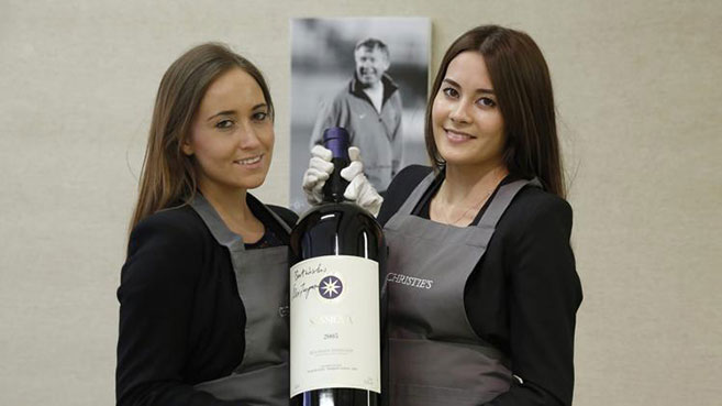 Christie's-employees-pose-with-a-bottle