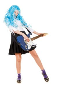 teen girl playing on a guitar, isolated on white