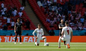 England's Mason Mount and Declan Rice take the knee before kick-off at Wembley. Photograph: Tom Jenkins/The Guardian